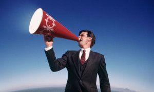 man shouts through megaphone
